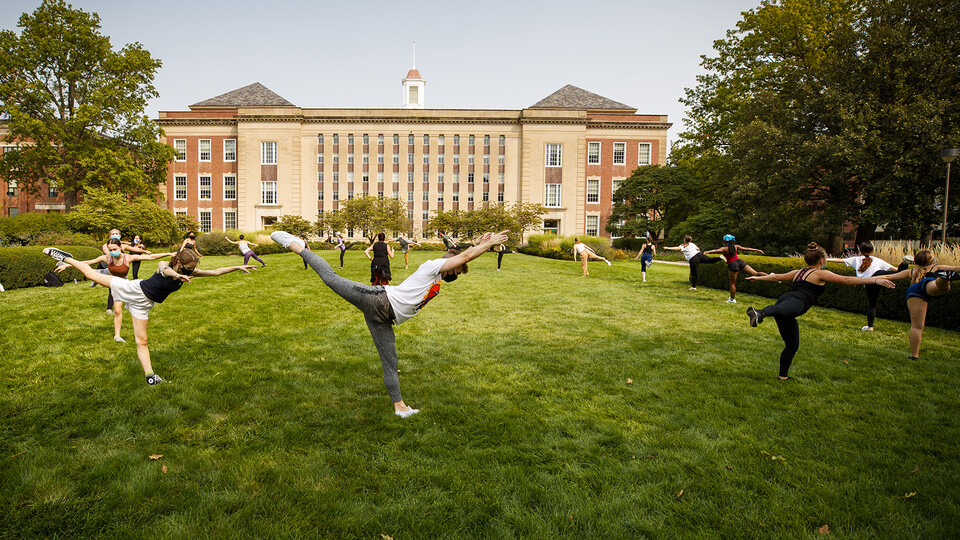 Students in a modern dance class led by Susan Ourada practice on the green space south of Love Library on Sept. 17. Support from donors has helped remove the university's dance program from a list of proposed budget reductions.
