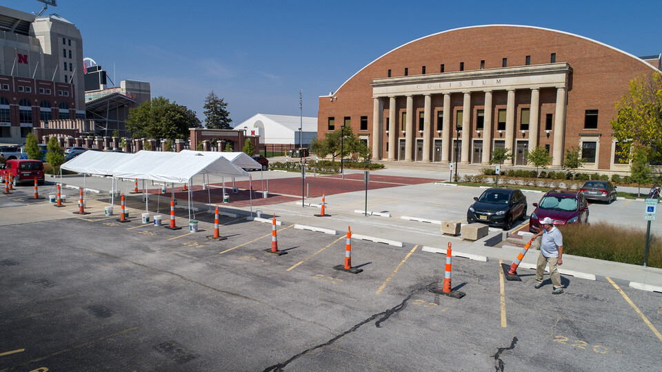 Jeff Culbertson, assistant director of operations for Landscape Services, places a traffic cone near the tents being used for randomized testing for COVID-19. The testing site is for students, faculty and staff who receive an email request.