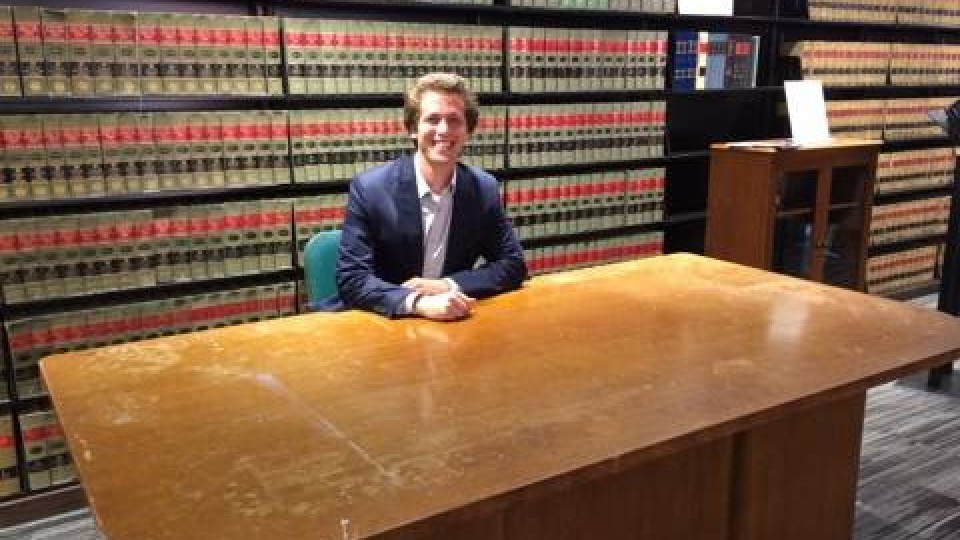 College of Law student Daniel Gutman of Omaha sits at the desk once used by Thurgood Marshall, the founder of the NAACP Legal Defense and Educational Fund and the first African-American U.S. Supreme Court Justice. Gutman is participating in a legal internship at LDF in New York made possible through a fellowship he received from the Nebraska Public Interest Law Fund.