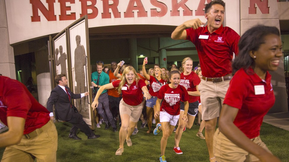 New students flood through Memorial Stadium's Gate 15 during Big Red Welcome activities on Aug. 22.
