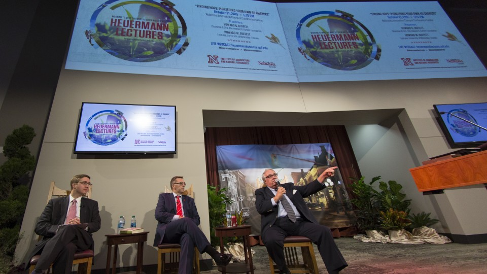 Howard G. Buffett (right) speaks during the Heuermann Lecture Oct. 21 at Nebraska Innovation Campus. Also on stage are speaker Howard W. Buffett (left) and moderator Ronnie Green, University of Nebraska vice president, IANR Harlan Vice Chancellor and interim senior vice chancellor for academic affairs at the University of Nebraska-Lincoln.