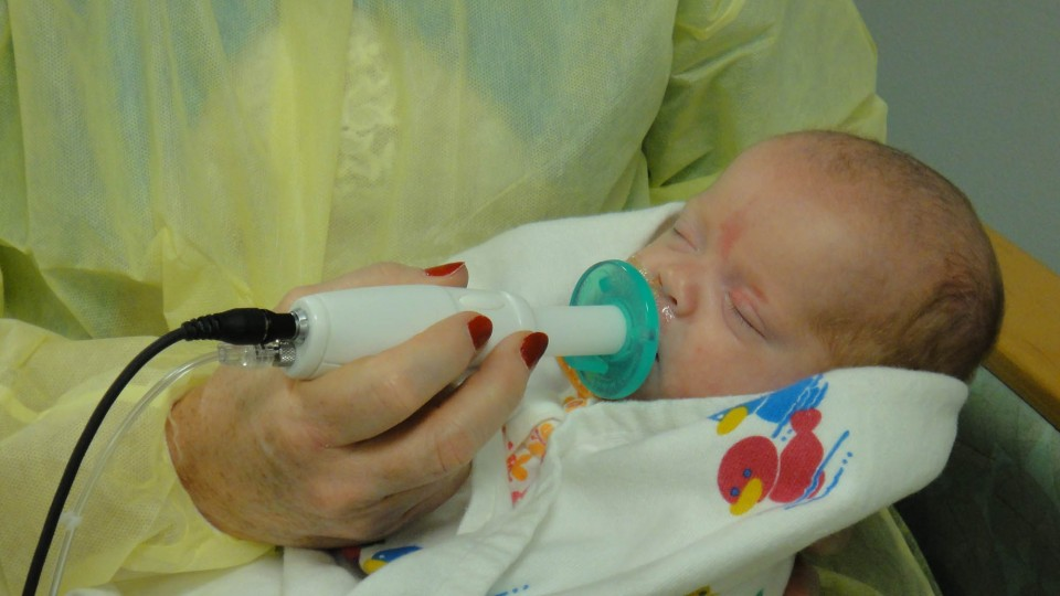 An infant uses the NTrainer System, a therapy device developed by UNL's Steven Barlow to stimulate early development of essential feeding skills in preterm infants.