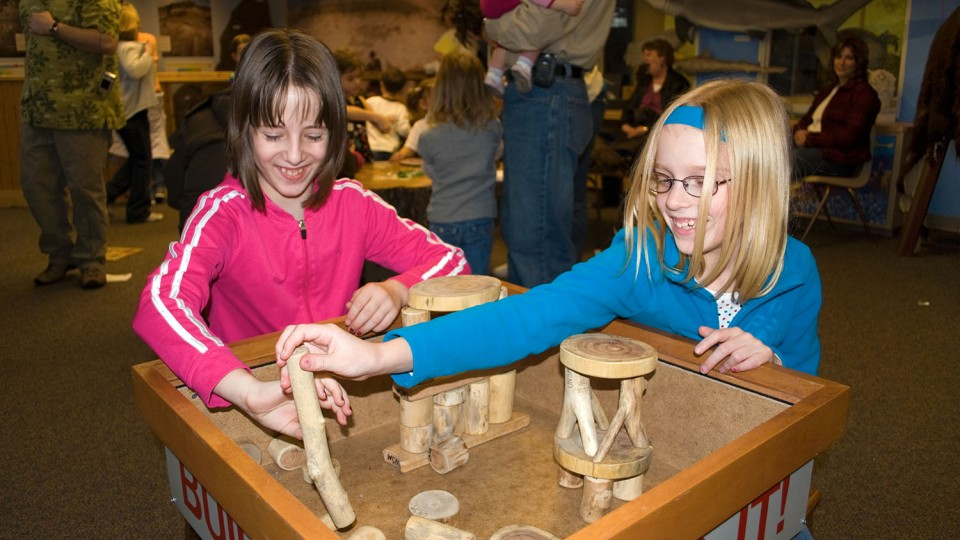 Young visitors explore science through hands-on activities in the Dr. Paul and Betty Marx Science Discovery Center in Morrill Hall. The museum will offer free admission from 4:30 to 8 p.m. each Thursday in July.