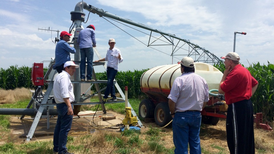 Argentine delegates discuss center pivot technology with Andy Suyker, associate professor in UNL's School of Natural Resources, during a visit to the Agricultural Research and Development Center near Mead on July 11.