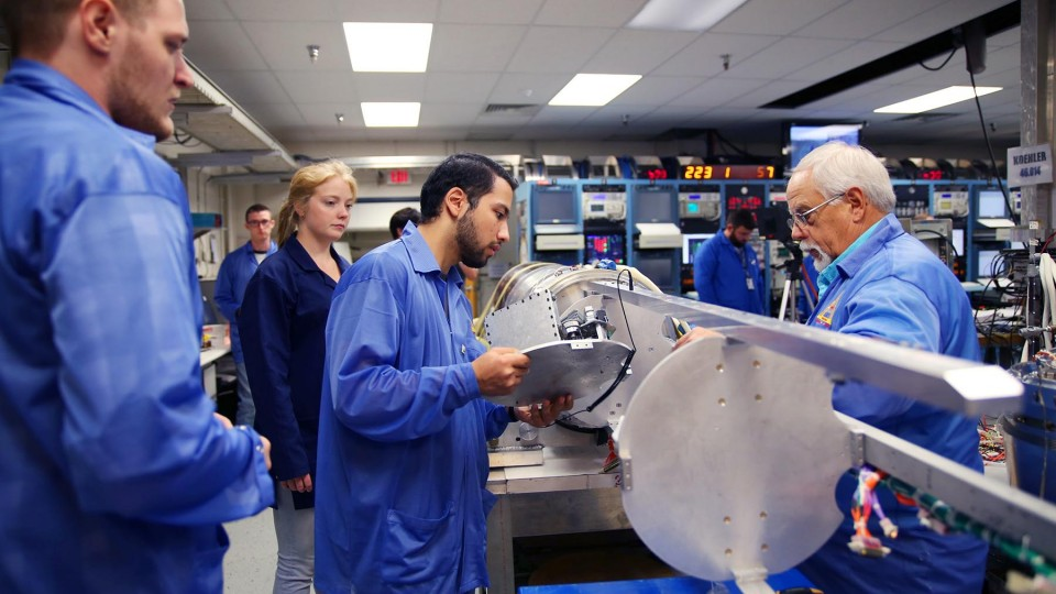 University of Nebraska-Lincoln student Firdavskhon Nasimov prepares to place the university's student experiment into the RockSat-X payload at the Wallops Flight Facility in Virginia.