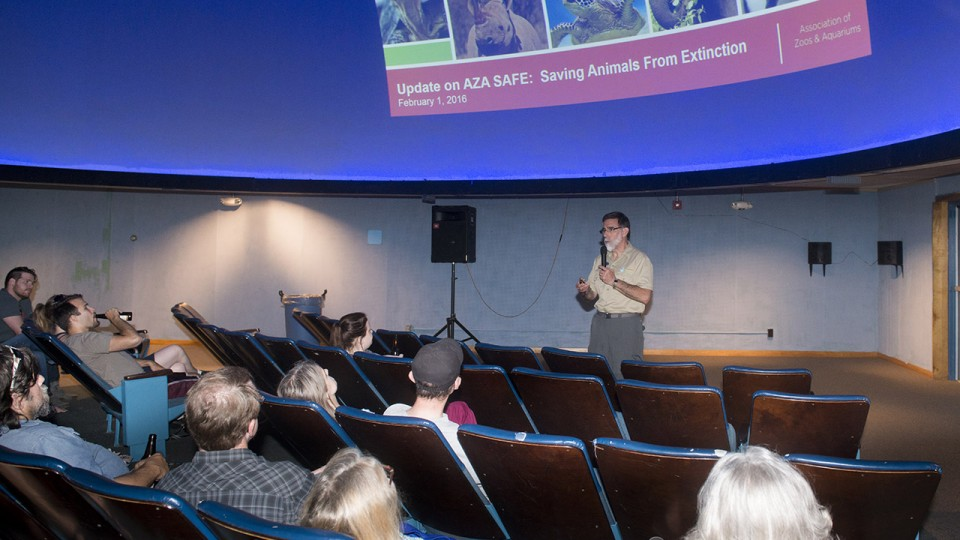 John Chapo, president and CEO of the Lincoln Children's Zoo, speaks during a Science Cafe program at Morrill Hall in June 2016. The series allows adults 21 and older to explore science and natural history topics in a casual environment.