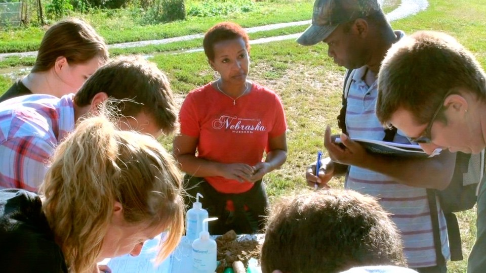 Martha Mamo, Weaver Professor of Agronomy and Horticulture, works with Nebraska students.