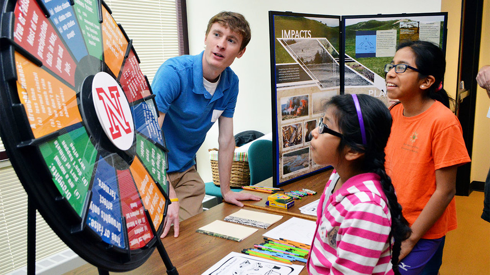 Claudia Carrillo (center) and Paula Carrillo (right) learn about drought from Jake Petr, a meteorology student in the School of Natural Resources, during the 16th annual Weatherfest in April 2016 at Hardin Hall. The 2017 event is April 1 at the Nebraska Innovation Campus Conference Center.
