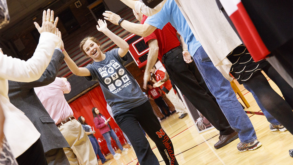 Katelyn Bendorf, an FFA member and University of Nebraska-Lincoln commit, receives high-fives during the signing ceremony April 6 at the Coliseum.