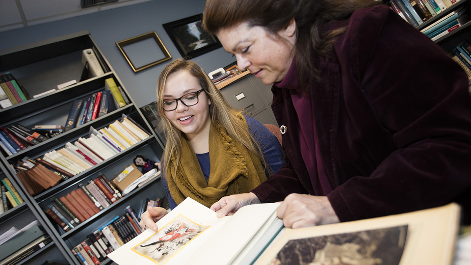 Student Amzie Dunekacke (left) works with Laura White, Weaver Professor of English at Nebraska, on a UCARE project in 2016. Eighty-eight Nebraska students have earned stipends to participate in research with faculty members this summer.