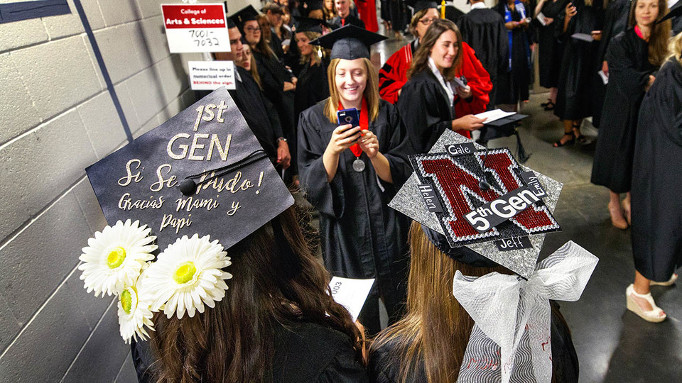 First-generation Husker Maritza Alvarez and fifth-generation Husker Lauren Hubka pose for a photo before the start of August commencement at Pinnacle Bank Arena.