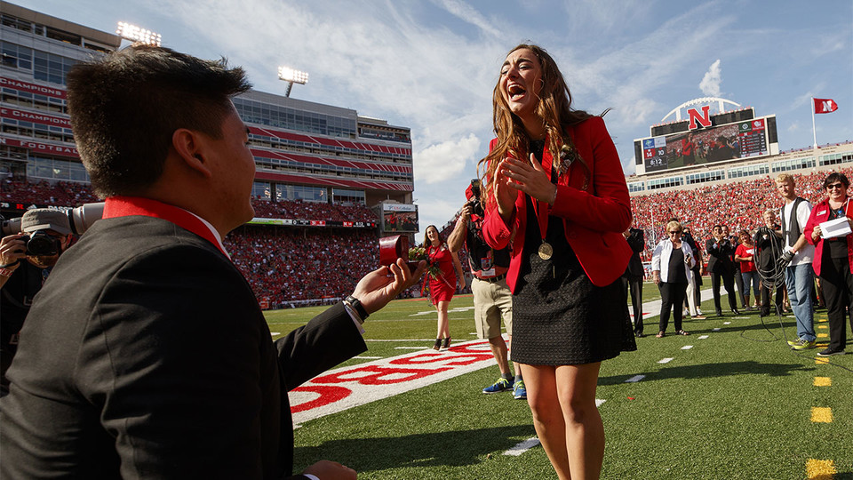 Homecoming king Shayne Arriola proposes to his girlfriend, homecoming queen Laura Springer, during halftime of the Nebraska-Rutgers football game on Sept. 23.