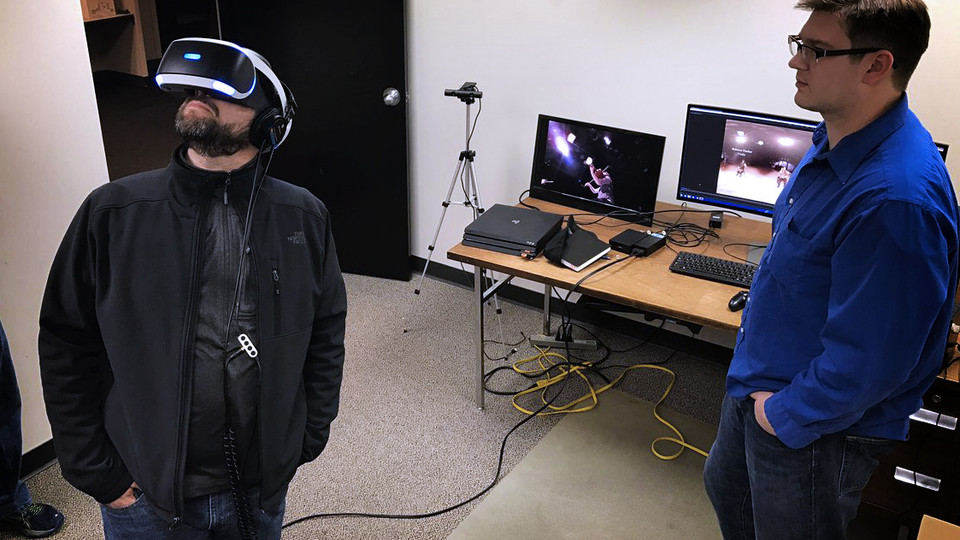 Adam Wagler, assistant professor of advertising, reviews 360-degree video with David Koehn, NET producer, as part of the collaboration to continue work in virtual reality research.
