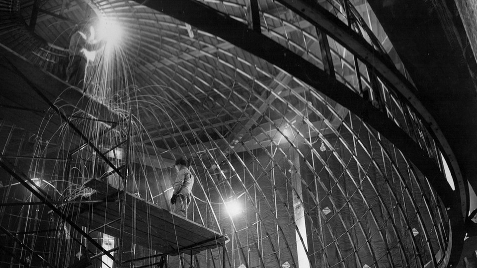 Construction workers weld metal support beams into place for the Mueller Planetarium dome in 1957. The planetarium will celebrate its 60th anniversary with a classic fulldome festival on March 24.