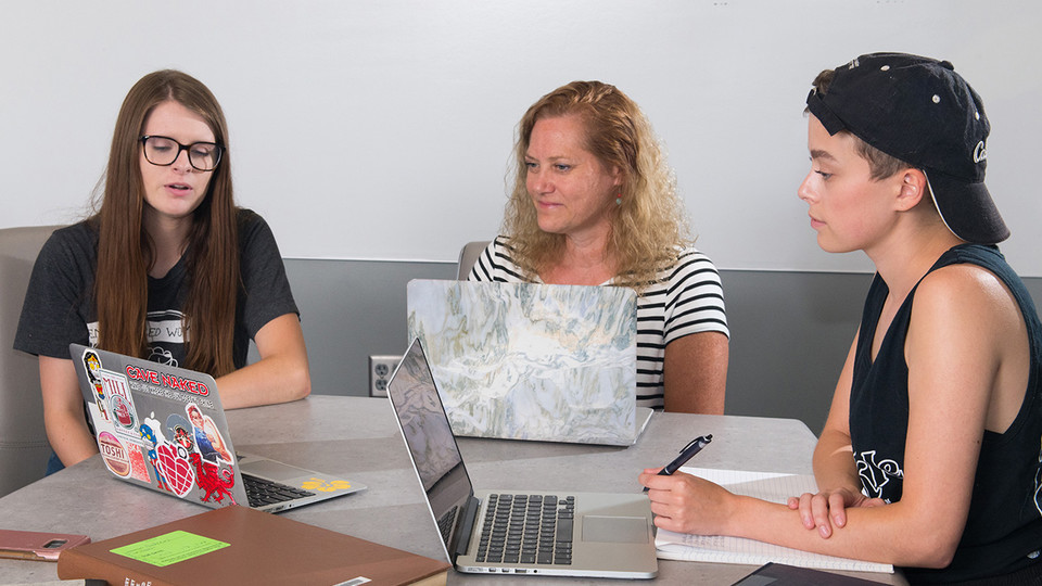 (From left) Rachel Gordon, Beverley Rilett and Megan Ekstrom discuss the George Eliot Archive during a meeting June 15 in the Adele Hall Learning Commons at Love Library. Not picture is team member Riley Jhi, who attended the meeting via Skype.