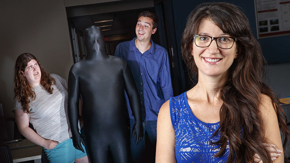 Maital Neta (front) was recently awarded a Faculty Early Career Development Program award from the National Science Foundation to study how humans respond differently to uncertainty. In this photo illustration, graduate students Catie Brown and Nick Harp react to a man dressed in a bodysuit to represent ambiguity.