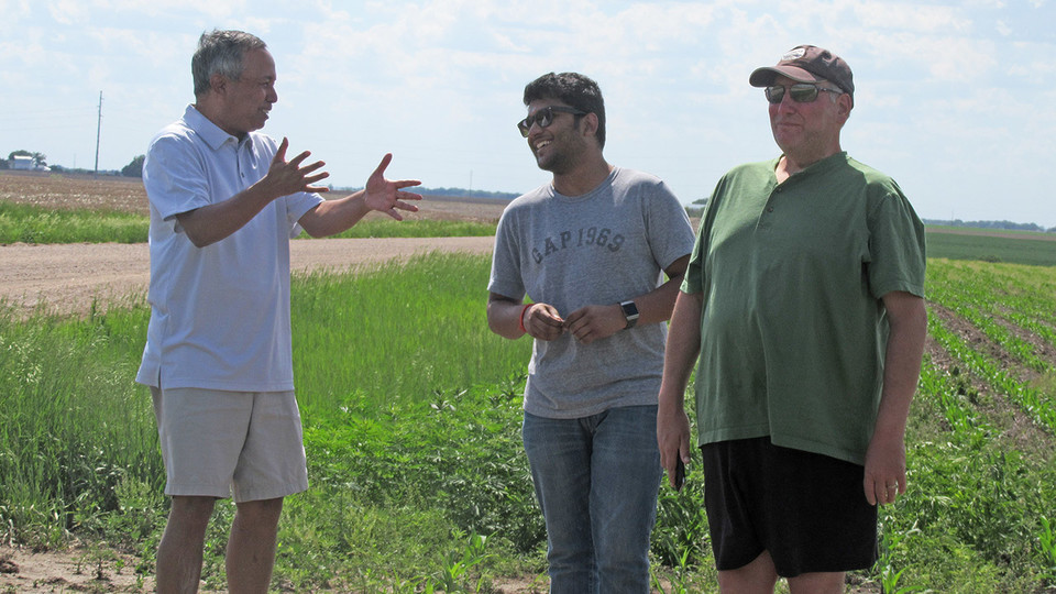 Rezaul Mahmood (left), co-leader of the GRAINEX project, talks with a student and co-leader Eric Rappin (right) of Western Kentucky University.