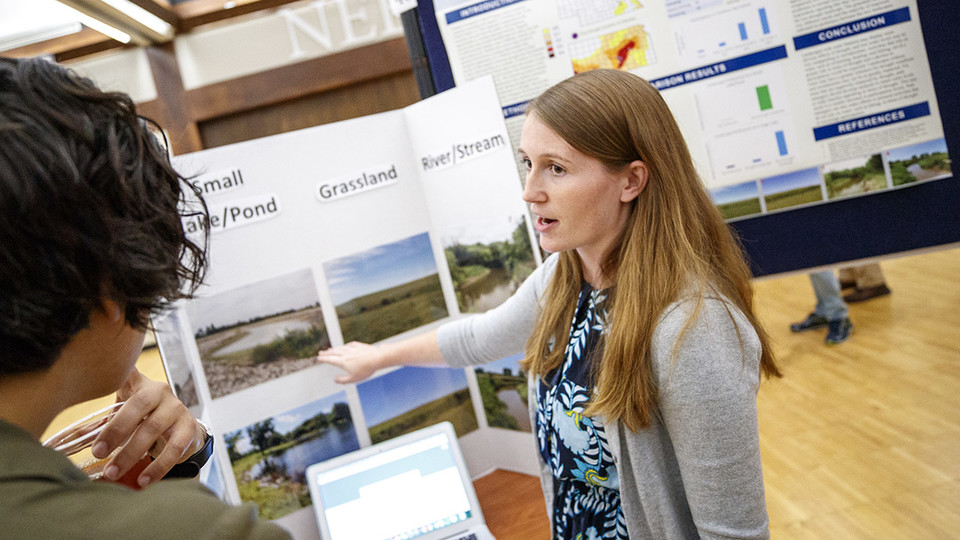 Cutline 1: Lauren Uhlig, a senior environmental studies and fisheries and wildlife major, presents findings from her summer UCARE project during a poster session Aug. 7 at the Nebraska Union. Uhlig worked closely with Deborah Bathke, a climate scientist at the National Drought Mitigation Center; and Theresa Jedd, an environmental policy specialist at the drought center; on the project.