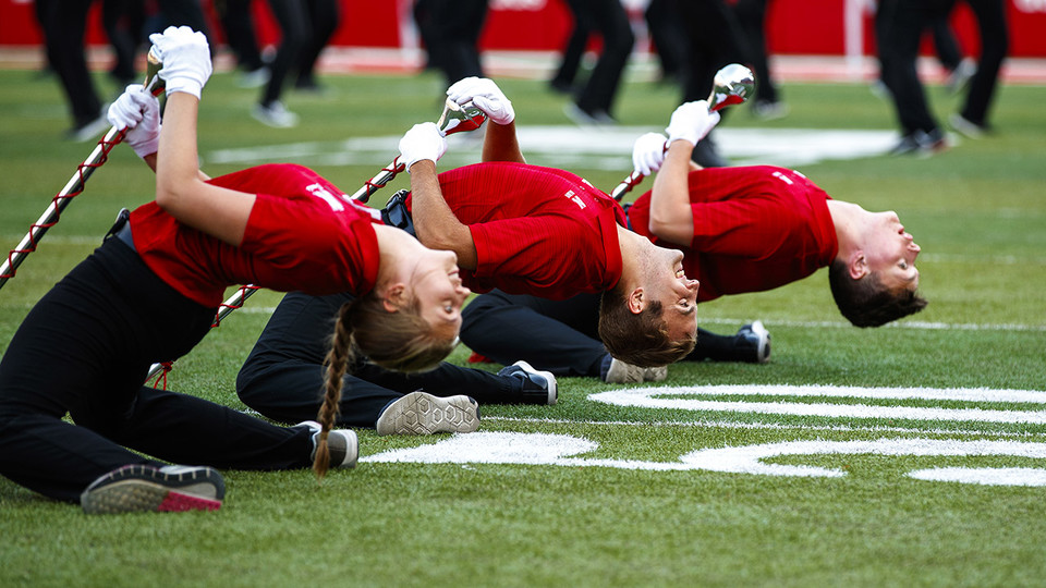 The drum majors take a bow before the Cornhusker Marching Band exhibition Aug. 17 at Memorial Stadium.