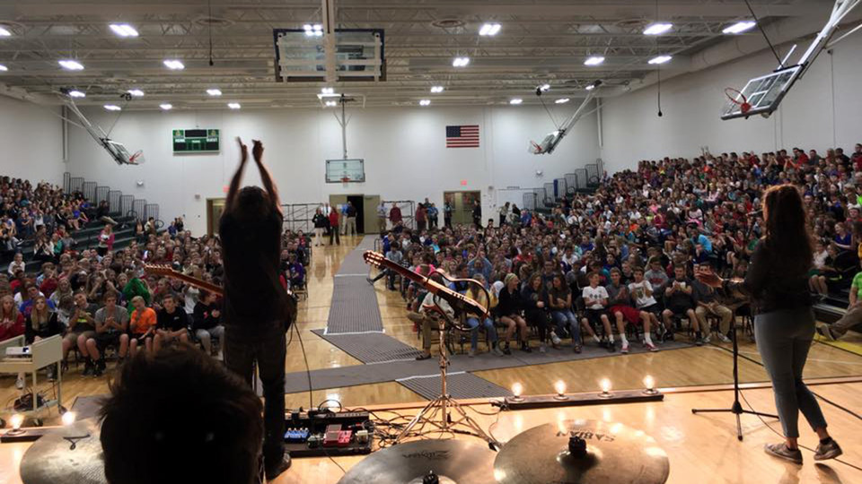 The band Gooding performs at Gretna High School during a previous financial literacy tour.