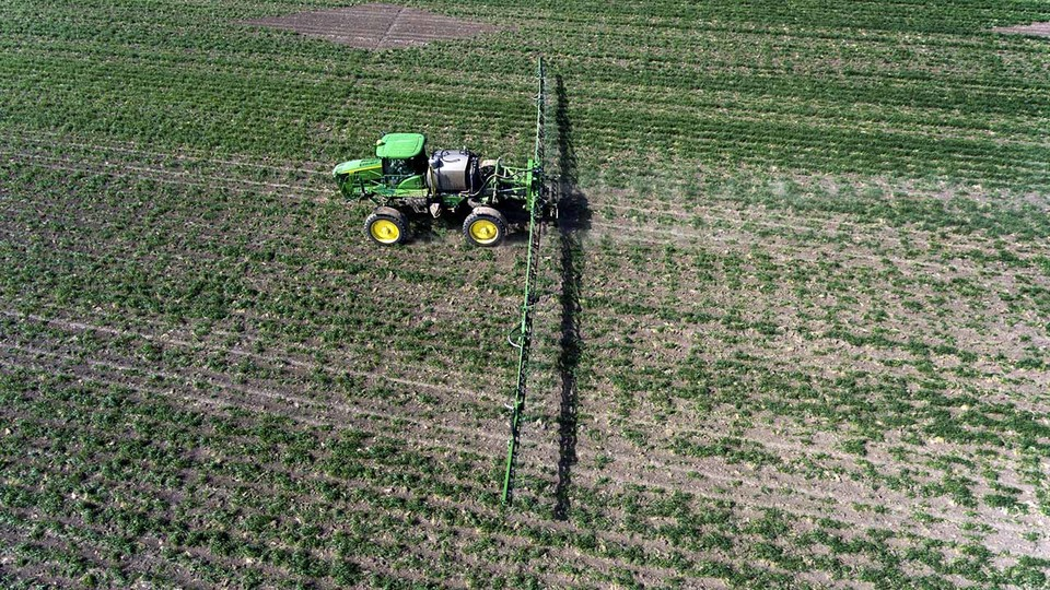 A farmer sprays cover crops to prepare for planting in April 2017 west of Holdrege. Nebraska Extension's Crop Production Roadshow will be in Holdrege on Jan. 25.