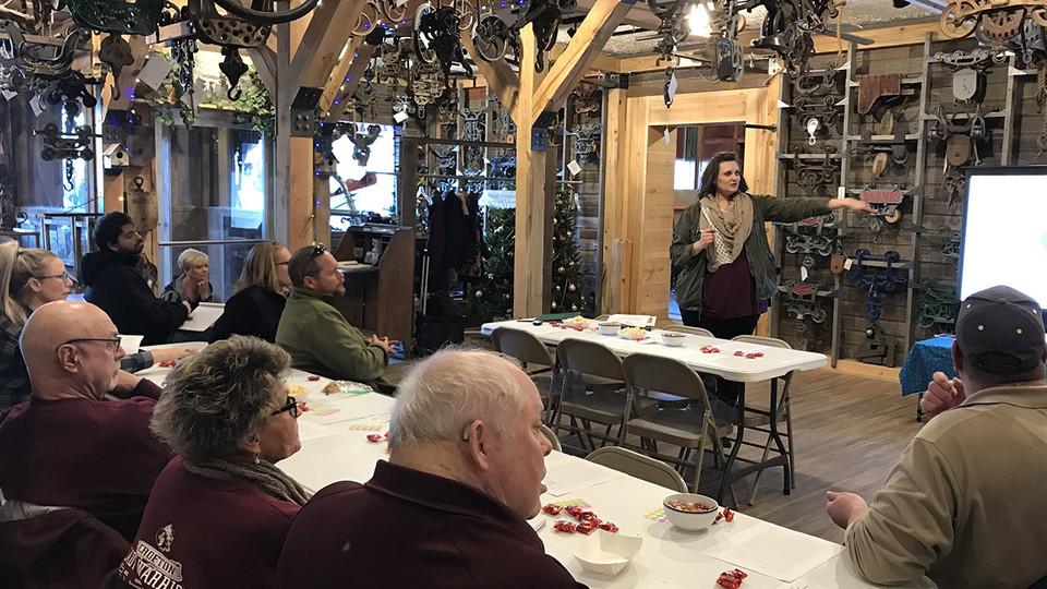 Megan Hanefeldt, with the Knox County Development Agency, talks with community members in Crofton.