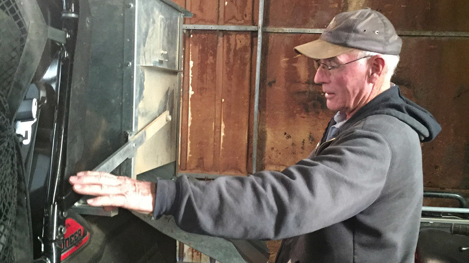 Nebraska rancher Rowan Ballagh uses assistive technology on his ranch in north-central Nebraska. AgrAbility helped with adding a specialized feeder in the back of a side-by-side utility vehicle to reduce lifting and carrying heavy bags of feed. In addition, they helped address his biggest need, his cattle chute. His manual chute required him to be standing, moving back and forth, and lifting both arms above his head, which was a challenge for him due to back pain, arthritis, weakness in his left arm and limited use of his right arm. Nebraska AgrAbility recommended a hydraulic chute in which all levers are at waist level and activated at the push of a button.