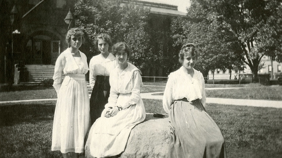"""A group of women poses in front of the University of Nebraska–Lincoln library (now Architecture Hall) circa 1915. """"What We Wore: Dressing Well at UNL,"""" featuring select garments from the 1870s through 1950s, is on view through May 10 at the Robert Hillestad Textiles Gallery."""