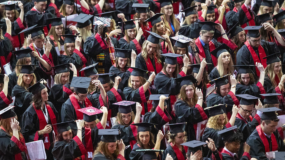 Huskers move their tassels from right to left to signify they are now graduates of the University of Nebraska-Lincoln at the end of the afternoon undergraduate commencement ceremony May 4 at Pinnacle Bank Arena.