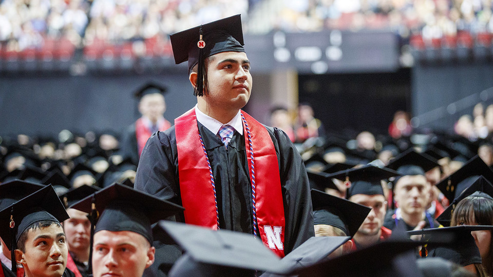 Juan Dominguez Jr. stands to be recognized along with other ROTC members of the graduating class during the morning undergraduate commencement ceremony May 4 at Pinnacle Bank Arena. He was commissioned a second lieutenant in the U.S. Army on May 4.