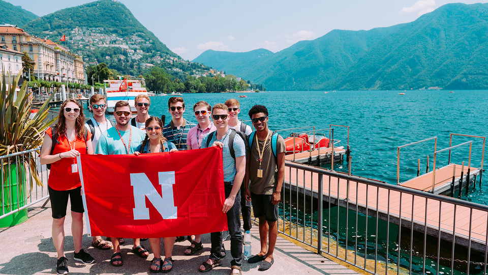 Husker choir students pose by Lake Lugano in Italy as part of an education abroad experience in summer 2019. Overall, 426 Husker students participated in faculty/staff led ed abroad experiences this summer.