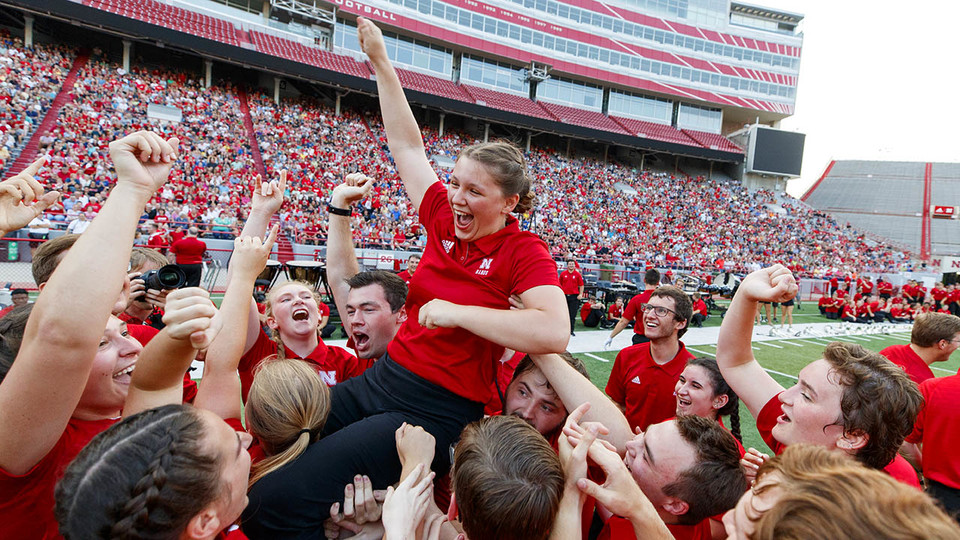 "Sophia Kallas of Green Bay, Wisconsin, is held aloft by fellow Cornhusker Marching Band members after winning the ""drill down"" competition during the 2018 exhibition. The 2019 event is 7 p.m. Aug. 23."