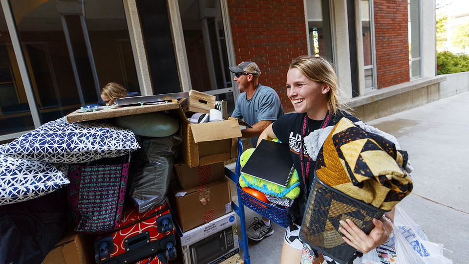 Makenzie Johnson moves into her room with the help of her parents, Ryan and Jennifer, in August 2018. This year, students will move in the week of Aug. 19.