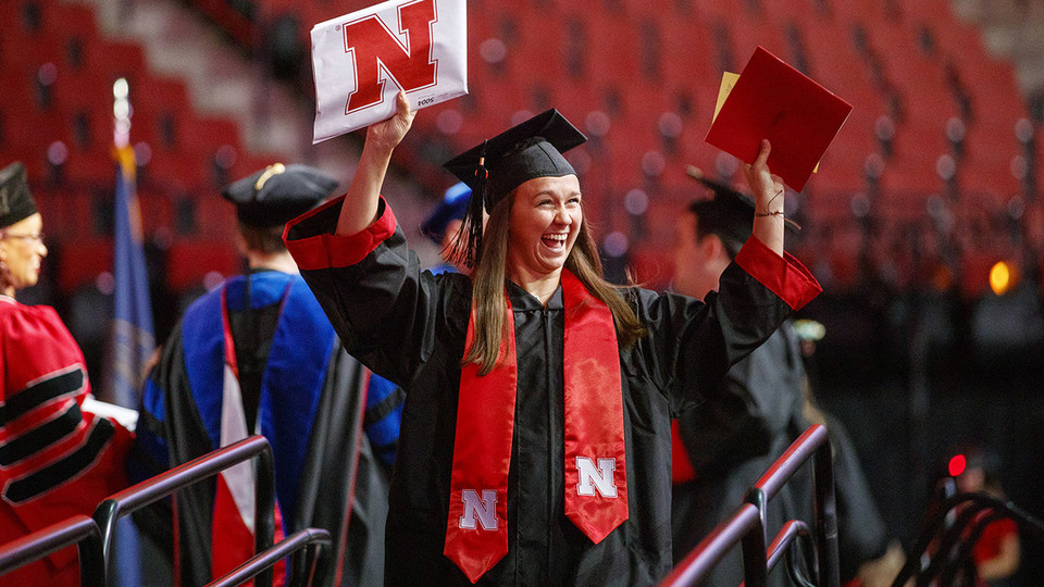 Nicole Colonna celebrates after receiving her degree during the summer commencement ceremony Aug. 17 at Pinnacle Bank Arena. She earned a Bachelor of Science in Education and Human Sciences.