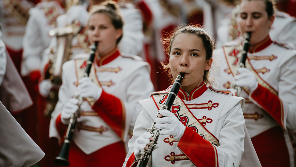 "In honor of the University of Nebraska–Lincoln's 150th anniversary this year, all Cornhusker Marching Band halftime shows will carry themes related to ""In Our Grit, Our Glory."""