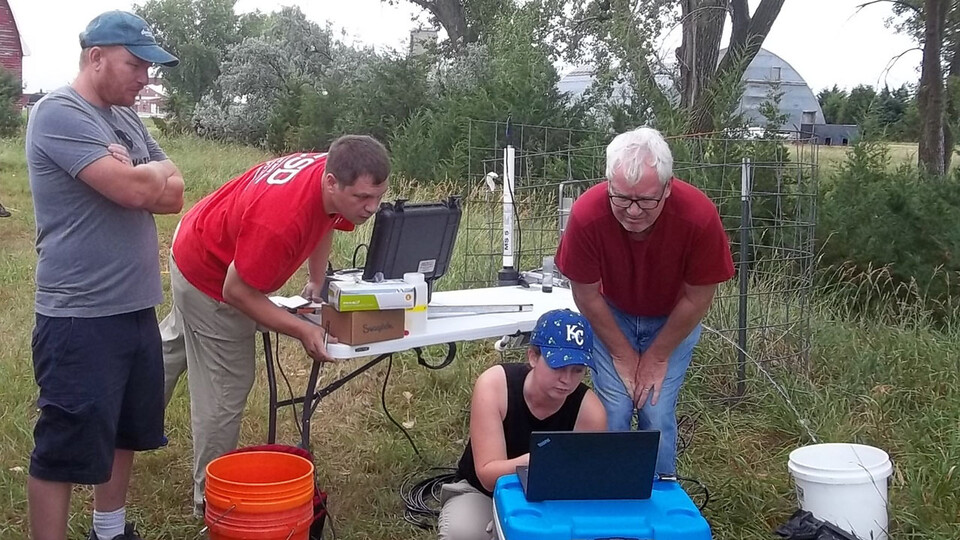 From left, Aaron Mittelstet, Troy Gilmore, Mikaela Cherry and Didier Gatsmana sample groundwater in the Little Blue Natural Resources District near Hastings in July 2018. A recent study from Cherry, doctoral candidate in the School of Natural Resources, and colleagues found that winter precipitation reloads most of the state's groundwater supply.