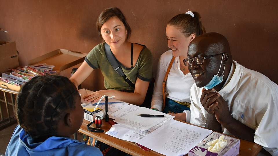 """Two University of Nebraska–Lincoln students sit in on a local meeting during their """"Food Security, Health and Nutrition"""" program in Zambia and Ethiopia in summer 2019. Led by Mary Willis, the study abroad program has included 15 Husker Gilman Scholars since its inception in 2014."""