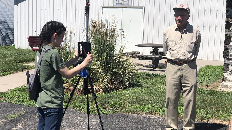 Rachel Williss, a junior agricultural and environmental sciences communication major at Nebraska, photographs Robert Diffendal, professor emeritus in the School of Natural Resources, during her fellowship this summer in Pawnee County. The Rural Fellows program is expanding in 2021, with up to 200 students and 100 communities to be accepted.