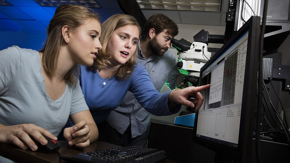 Nicole Iverson (center), assistant professor of biological systems engineering at Nebraska, works with then-undergraduate Janelle Adams and graduate student Eric Hofferber in August 2016. The Iverson Lab has earned a $1.77 million grant from the Department of Health and Human Services to make nitric oxide sensors easy to use and to utilize them to study both healthy and diseased cells.