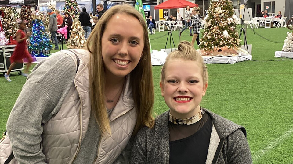 Ashley McMurchie, a junior microbiology and Spanish major from Omaha, cheers on her leadership mentee, Lily, a 16-year-old high school student from Lincoln, in this photo taken before the COVID-19 pandemic.