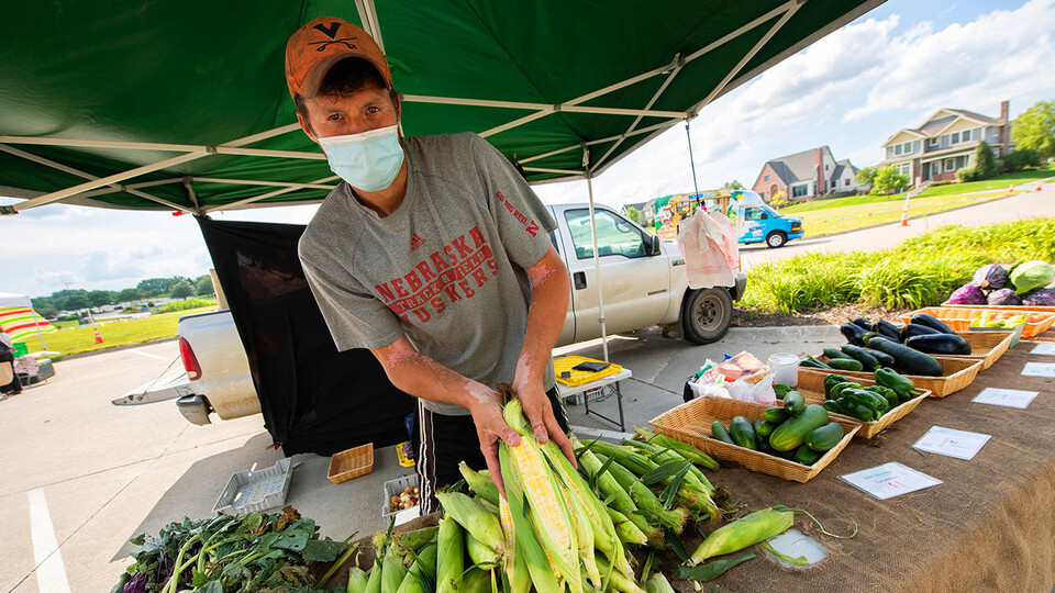 A vendors sells produce at the Fallbrook Farmers Market in northwest Lincoln on July 23. A new $1 million, three-year grant will allow Nebraska Extension to expand the Double Up Food Bucks program to more grocery stores and farmers markets across the state.