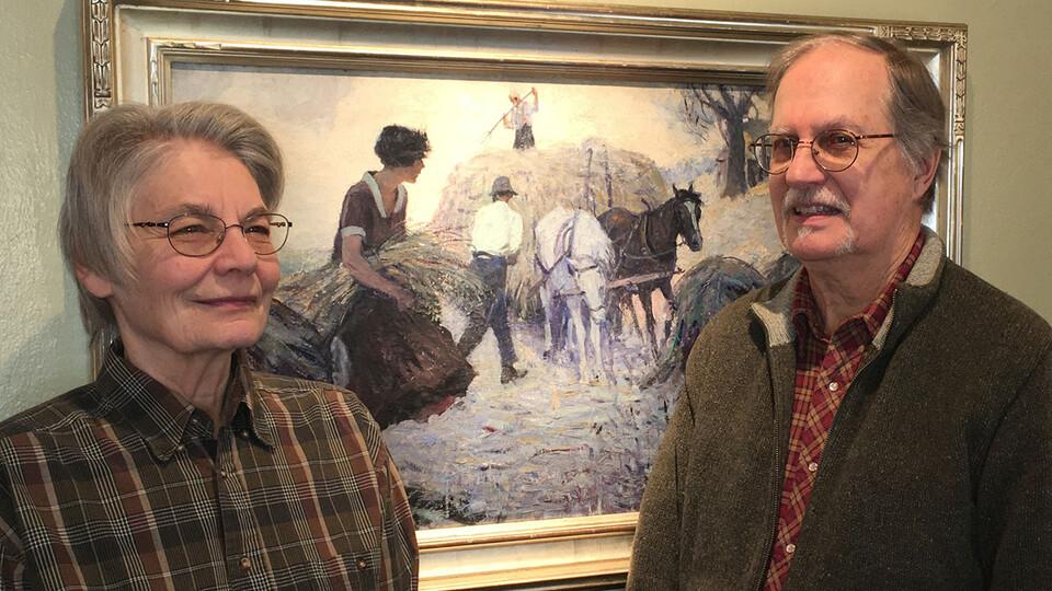 "Carol and Mark Moseman of David City, Nebraska, with ""Fighting Blood,"" a painting by Frank L. Spradling (1885–1972)."