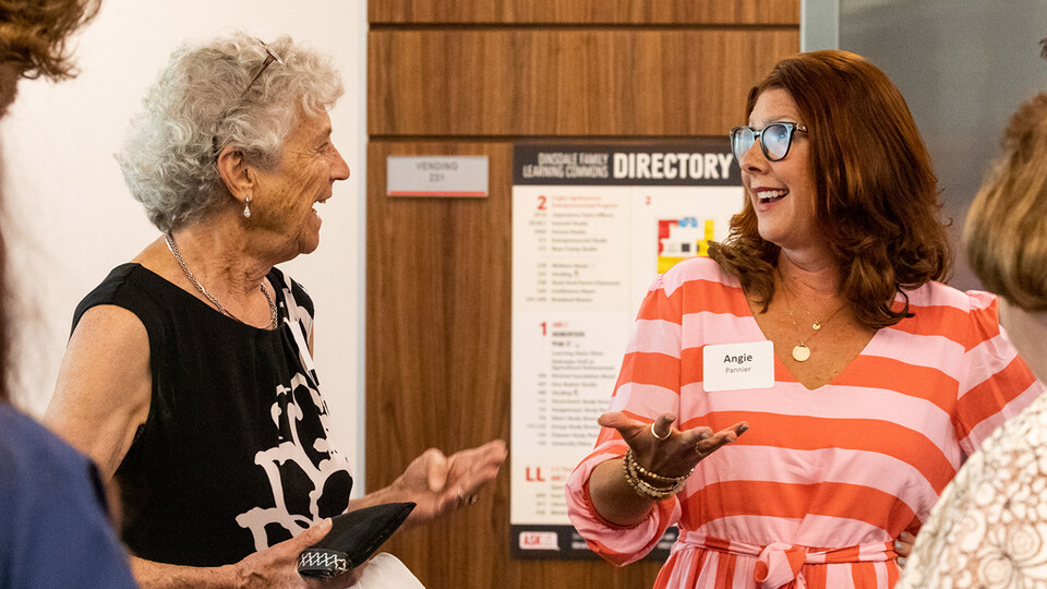 Dr. Carol Swarts (left) chats with Angela Pannier during the July 13 ceremony recognizing Pannier as the inaugural Swarts Family Chair in Biological Systems Engineering.