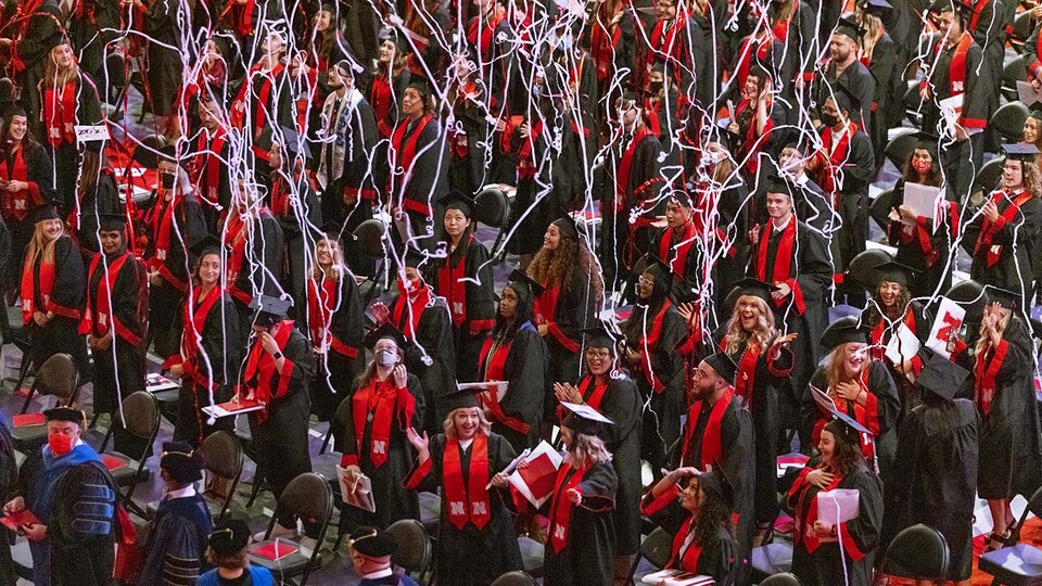 Streamers float down at the end of the undergraduate commencement ceremony Aug. 14 at Pinnacle Bank Arena.