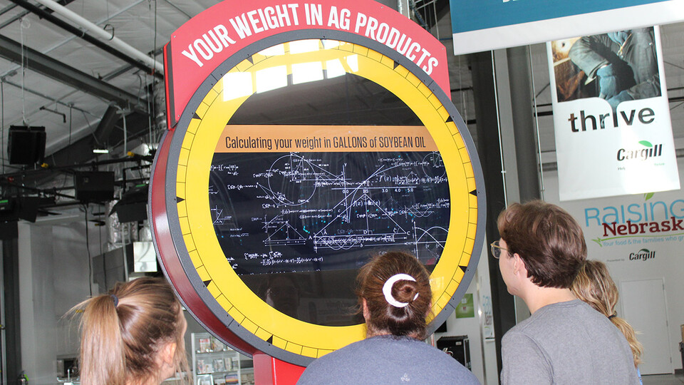 New activities at Raising Nebraska include a giant scale that translates a visitor's weight into bushels of grain, number of newborn pigs, gallons of milk or about a dozen other Nebraska agricultural products.