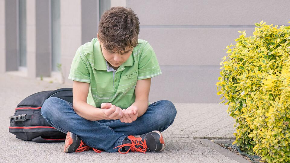 Teen boy looking forlorn
