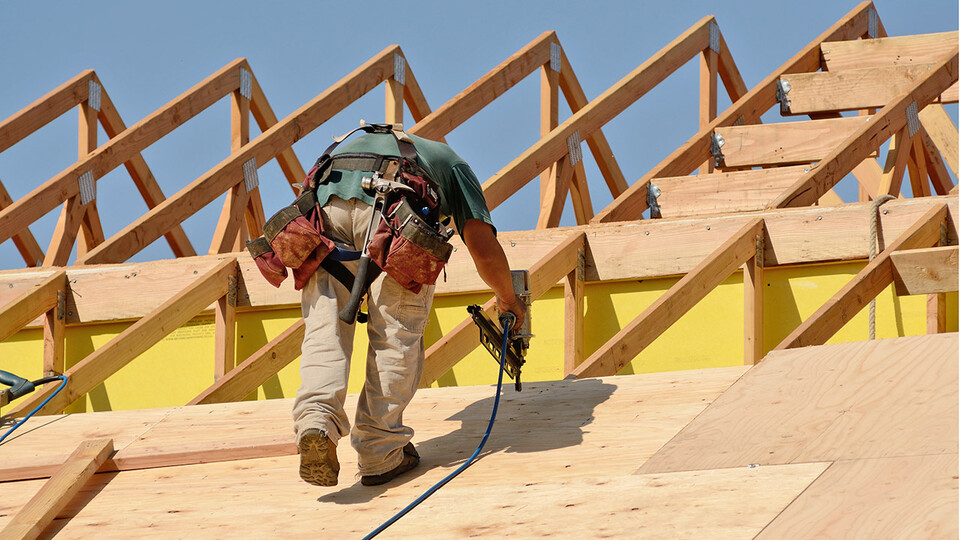 Man working on roof construction