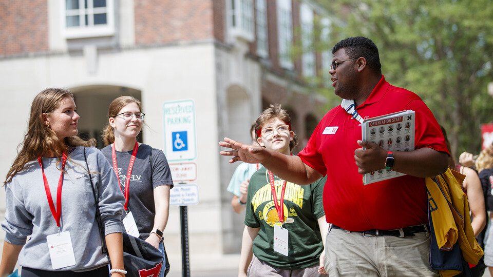 Orientation leader Jayven Brandt shares his experiences as a Husker with incoming freshmen outside the Nebraska Union.