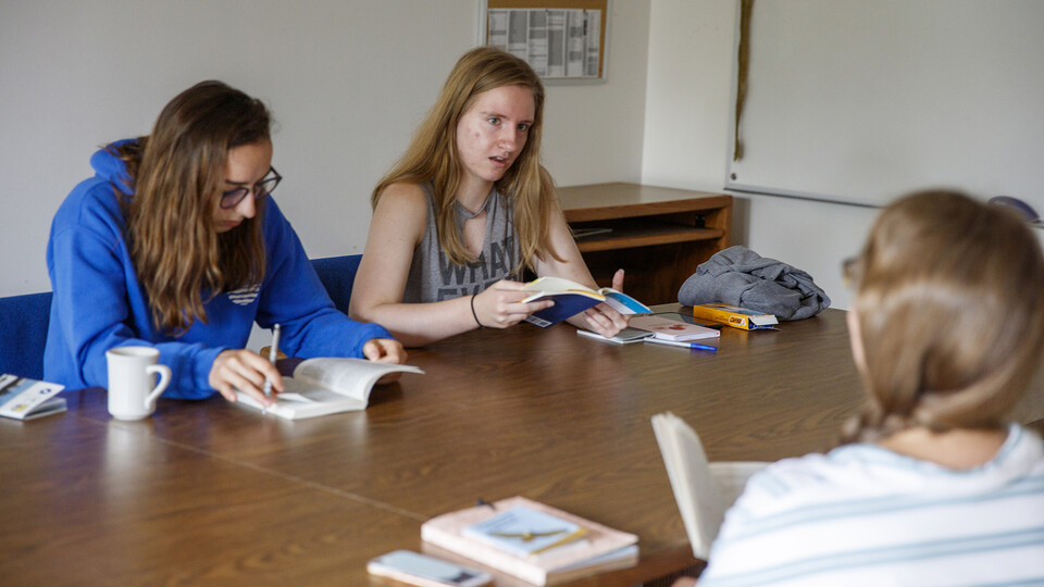 Literature students sit around a table at Cedar Point Biological Station.