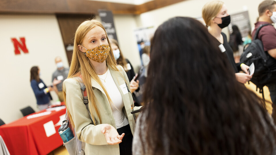 Jayme Soderbeck, a junior in management, talks with recruiters at the Career Fair Sept. 21.